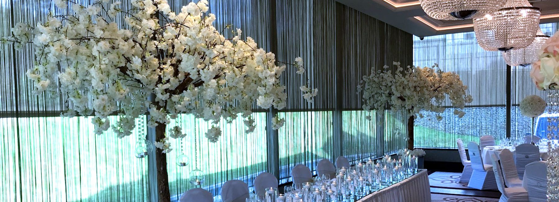 Photo of Wedding blossom trees and wedding candles